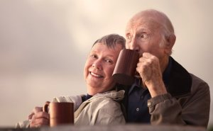 elderly-couple-outside-drinking-coffee