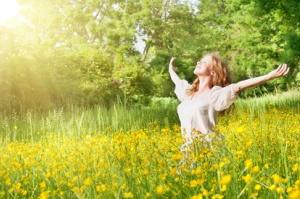 beautiful girl enjoying the summer sun outdoors in the park